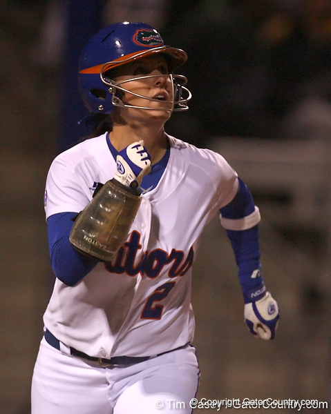photo by Tim Casey<br /> <br /> Florida sophomore Kelsey Bruder watches her solo home run sail over the right field fence during the fourth inning of the Gators' 3-0 win against the Baylor Bears on Friday, February 6, 2009 at Katie Seashole Pressly Softball Stadium in Gainesville, Fla.