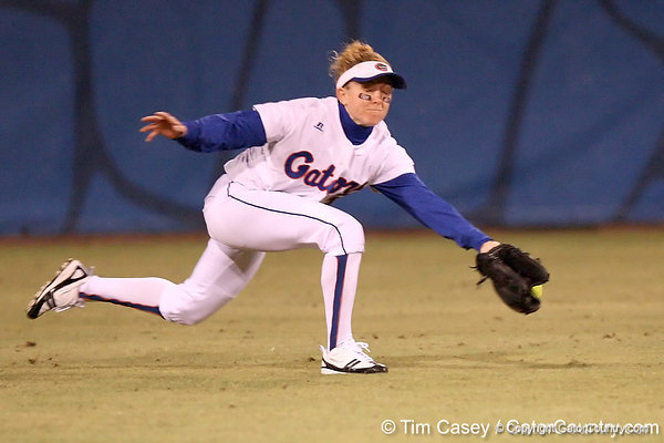 photo by Tim Casey<br /> <br /> Florida senior Kim Waleszonia dives for a ball in the sixth inning during the Gators' 3-0 win against the Baylor Bears on Friday, February 6, 2009 at Katie Seashole Pressly Softball Stadium in Gainesville, Fla.