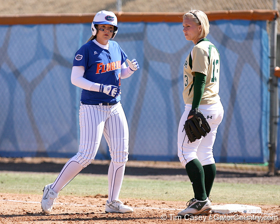 photo by Tim Casey<br /> <br /> Florida sophomore shortstop Megan Bush returns to first base after hitting a single during the fifth inning of the Gators' 1-0 loss to the Baylor Bears on Sunday, February 8, 2009 at Katie Seashole Pressly Softball Stadium in Gainesville, Fla.