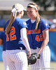 photo by Tim Casey<br /> <br /> Florida sophomore shortstop Megan Bush talks with senior pitcher Stacey Nelson during the fifth inning of the Gators' 1-0 loss to the Baylor Bears on Sunday, February 8, 2009 at Katie Seashole Pressly Softball Stadium in Gainesville, Fla.