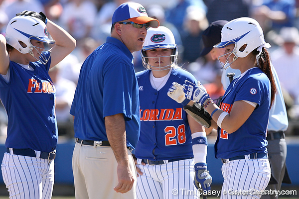 photo by Tim Casey<br /> <br /> Florida head coach Tim Walton talks with his players during the sixth inning of the Gators' 1-0 loss to the Baylor Bears on Sunday, February 8, 2009 at Katie Seashole Pressly Softball Stadium in Gainesville, Fla.