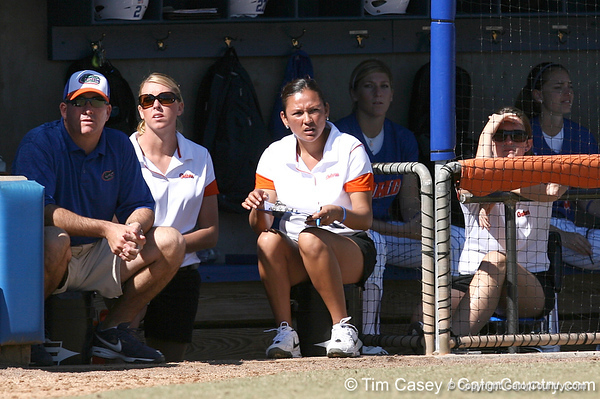 photo by Tim Casey<br /> <br /> Florida head coach Tim Walton, assistant coach Jenny Gladding and assistant coach Jennifer Rocha watch from the dugout during the second inning of the Gators' 1-0 loss to the Baylor Bears on Sunday, February 8, 2009 at Katie Seashole Pressly Softball Stadium in Gainesville, Fla.