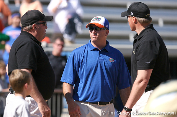 photo by Tim Casey<br /> <br /> Florida head coach Tim Walton talks with Baylor coaches after the Gators' 1-0 loss to the Bears on Sunday, February 8, 2009 at Katie Seashole Pressly Softball Stadium in Gainesville, Fla.