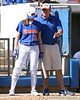 photo by Tim Casey<br /> <br /> Florida junior left fielder Francesca Enea listens to head coach Tim Walton during the third inning of the Gators' 1-0 loss to the Baylor Bears on Sunday, February 8, 2009 at Katie Seashole Pressly Softball Stadium in Gainesville, Fla.