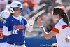 photo by Tim Casey<br /> <br /> Florida sophomore shortstop Megan Bush slaps hands with student coach Mary Ratliff during the fifth inning of the Gators' 1-0 loss to the Baylor Bears on Sunday, February 8, 2009 at Katie Seashole Pressly Softball Stadium in Gainesville, Fla.