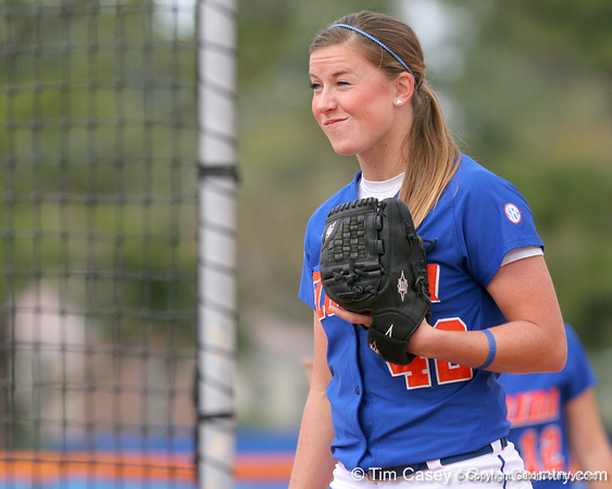 photo by Tim Casey<br /> <br /> Florida senior Stacey Nelson eyes Billy Donovan during the Gator softball team's Swinging for Cancer event on Sunday, February 1, 2009 at Katie Seashole Pressly Softball Stadium in Gainesville, Fla.