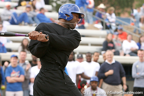 photo by Tim Casey<br /> <br /> Florida football's John Curtis gets a hit during the Gator softball team's Swinging for Cancer event on Sunday, February 1, 2009 at Katie Seashole Pressly Softball Stadium in Gainesville, Fla.