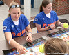 photo by Tim Casey<br /> <br /> Florida sophomore Tiffany DeFelice autographs a ball during the Gator softball team's Swinging for Cancer event on Sunday, February 1, 2009 at Katie Seashole Pressly Softball Stadium in Gainesville, Fla.