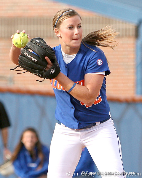 photo by Tim Casey<br /> <br /> Florida senior Stacey Nelson fakes a throw to first base after baseball head coach Kevin O'Sullivan hit a weak ground ball during the Gator softball team's Swinging for Cancer event on Sunday, February 1, 2009 at Katie Seashole Pressly Softball Stadium in Gainesville, Fla.