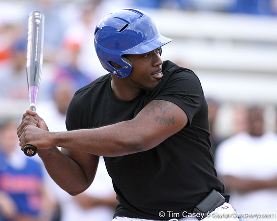 photo by Tim Casey<br /> <br /> Florida football linebacker Dustin Doe bats during the Gator softball team's Swinging for Cancer event on Sunday, February 1, 2009 at Katie Seashole Pressly Softball Stadium in Gainesville, Fla.