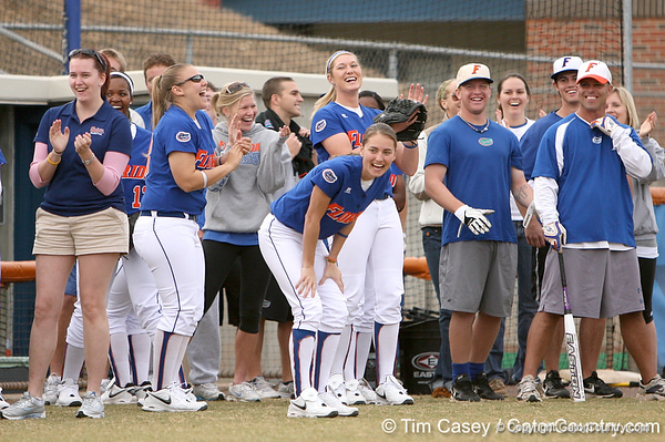 photo by Tim Casey<br /> <br /> Players laugh after Nicola Willis got a hit during the Gator softball team's Swinging for Cancer event on Sunday, February 1, 2009 at Katie Seashole Pressly Softball Stadium in Gainesville, Fla.