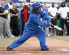 photo by Tim Casey<br /> <br /> Florida gymnast Melanie Sinclair swings at a pitch during the Gator softball team's Swinging for Cancer event on Sunday, February 1, 2009 at Katie Seashole Pressly Softball Stadium in Gainesville, Fla.