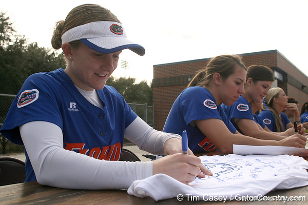 photo by Tim Casey<br /> <br /> Florida senior Kim Waleszonia autographs a shirt during the Gator softball team's Swinging for Cancer event on Sunday, February 1, 2009 at Katie Seashole Pressly Softball Stadium in Gainesville, Fla.