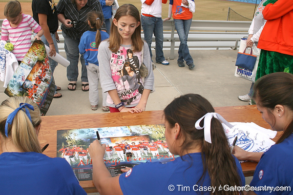 photo by Tim Casey<br /> <br /> Florida senior Ali Gardiner autographs a poster during the Gator softball team's Swinging for Cancer event on Sunday, February 1, 2009 at Katie Seashole Pressly Softball Stadium in Gainesville, Fla.