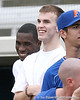 photo by Tim Casey<br /> <br /> Florida basketball's Vernon Macklin and Nick Calathes watch during the Gator softball team's Swinging for Cancer event on Sunday, February 1, 2009 at Katie Seashole Pressly Softball Stadium in Gainesville, Fla.