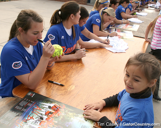 photo by Tim Casey<br /> <br /> Florida senior Kristina Hilberth autographs a ball during the Gator softball team's Swinging for Cancer event on Sunday, February 1, 2009 at Katie Seashole Pressly Softball Stadium in Gainesville, Fla.
