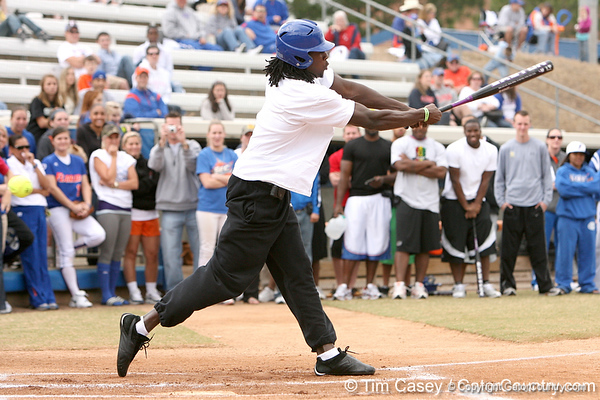 photo by Tim Casey<br /> <br /> Florida football's rising senior cornerback Wondy Pierre-Louis bats during the Gator softball team's Swinging for Cancer event on Sunday, February 1, 2009 at Katie Seashole Pressly Softball Stadium in Gainesville, Fla.
