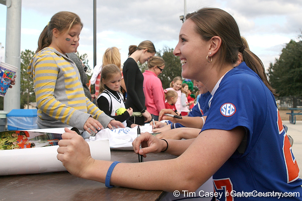 photo by Tim Casey<br /> <br /> Florida junior Corrie Brooks talks with a fan during the Gator softball team's Swinging for Cancer event on Sunday, February 1, 2009 at Katie Seashole Pressly Softball Stadium in Gainesville, Fla.