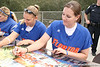 photo by Tim Casey<br /> <br /> Florida junior Corrie Brooks autographs a poster during the Gator softball team's Swinging for Cancer event on Sunday, February 1, 2009 at Katie Seashole Pressly Softball Stadium in Gainesville, Fla.