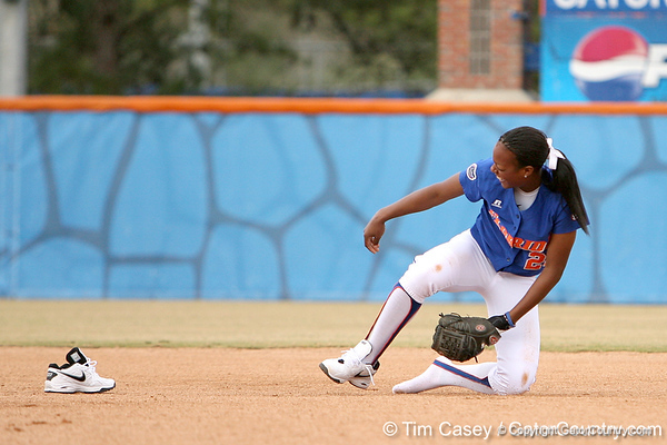 photo by Tim Casey<br /> <br /> Florida senior Le-Net Franklin loses a shoe chasing a ground ball during the Gator softball team's Swinging for Cancer event on Sunday, February 1, 2009 at Katie Seashole Pressly Softball Stadium in Gainesville, Fla.