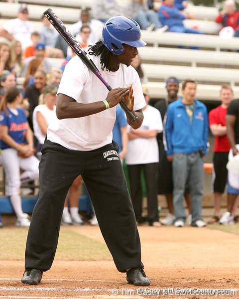 photo by Tim Casey<br /> <br /> Florida football's rising senior cornerback Wondy Pierre-Louis pleads for mercy during the Gator softball team's Swinging for Cancer event on Sunday, February 1, 2009 at Katie Seashole Pressly Softball Stadium in Gainesville, Fla.