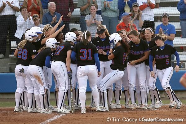 photo by Tim Casey<br /> <br /> Florida sophomore Kelsey Bruder crosses the plate after hitting a three-run home run during the third inning of the Gators' 10-5 win against the Pacific Tigers on Friday, February 27, 2009 at Katie Seashole Pressly Softball Stadium in Gainesville, Fla.