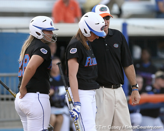 photo by Tim Casey<br /> <br /> Florida junior left fielder Francesca Enea listens to instructions from head coach Tim Walton during the Gators' 10-5 win against the Pacific Tigers on Friday, February 27, 2009 at Katie Seashole Pressly Softball Stadium in Gainesville, Fla.