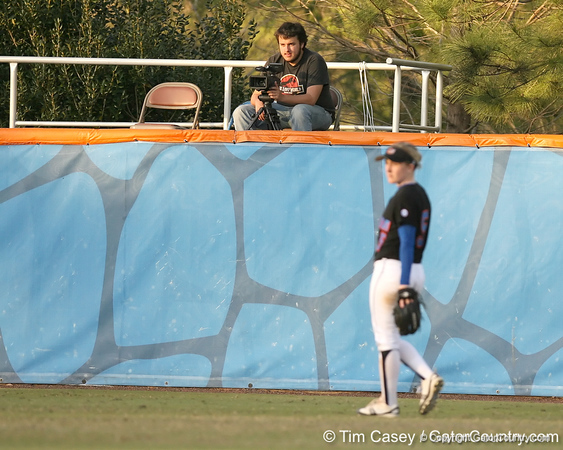 photo by Tim Casey<br /> <br /> Gator Country videographer Jeremy Silveira watches from center field during the second inning of the Gators' 10-5 win against the Pacific Tigers on Friday, February 27, 2009 at Katie Seashole Pressly Softball Stadium in Gainesville, Fla.