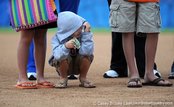 Children stand on the UF softball field during the Gators return to Katie Seashole Pressly Stadium in Gainesville, Fla. on Wednesday, June 3, 2009. The team greeted the president of the university as well as fans after their loss to Washington in the finals of the College World Series. / Gator Country photo by Casey Brooke Lawson