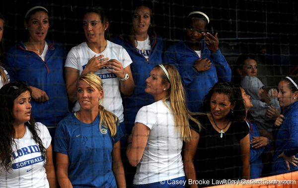 The University of Florida softball team stands in the dugout during a rain shower after their return to Katie Seashole Pressly Stadium in Gainesville, Fla. on Wednesday, June 3, 2009. / Gator Country photo by Casey Brooke Lawson