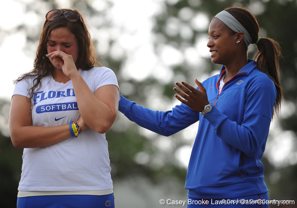 Senior Le-Net Franklin comforts senior first basemen Ali Gardiner while standing on the field of Katie Seashole Pressly Stadium in Gainesville, Fla. on Wednesday, June 3, 2009 after the teams' return from the College World Series in Oklahoma City. / Gator Country photo by Casey Brooke Lawson