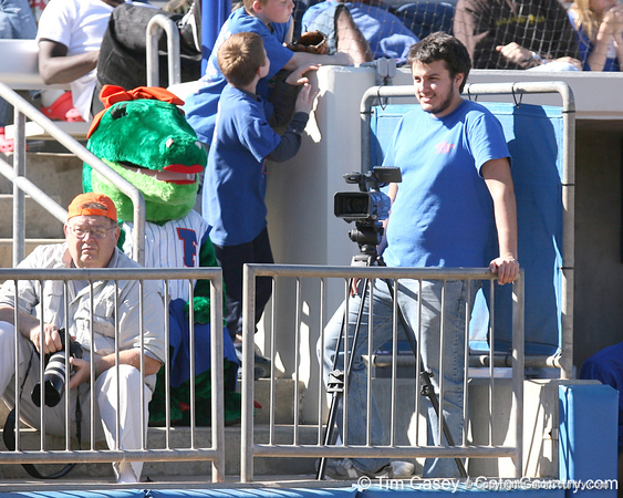 photo by Tim Casey<br /> <br /> Gator Country videographer Jeremy Silveira looks excited during the Gators' 8-0 win against the Baylor Bears on Saturday, February 7, 2009 at Katie Seashole Pressly Softball Stadium in Gainesville, Fla.