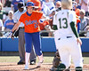 photo by Tim Casey<br /> <br /> Florida junior third baseman Corrie Brooks scores on a sacrifice fly in the second inning during the Gators' 8-0 win against the Baylor Bears on Saturday, February 7, 2009 at Katie Seashole Pressly Softball Stadium in Gainesville, Fla.