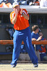 photo by Tim Casey<br /> <br /> Florida head coach Tim Walton applauds after freshman Alicia Sisco recorded her first career hit during the Gators' 8-0 win against the Baylor Bears on Saturday, February 7, 2009 at Katie Seashole Pressly Softball Stadium in Gainesville, Fla.