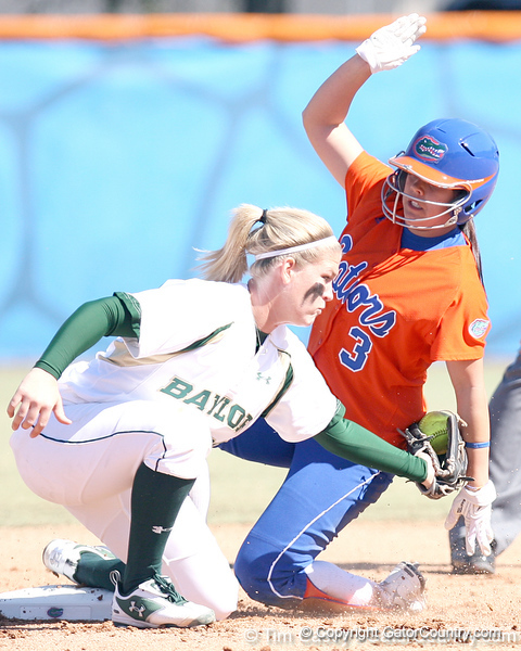 photo by Tim Casey<br /> <br /> Florida sophomore second baseman Aja Paculba steals second base in the first inning during the Gators' 8-0 win against the Baylor Bears on Saturday, February 7, 2009 at Katie Seashole Pressly Softball Stadium in Gainesville, Fla.