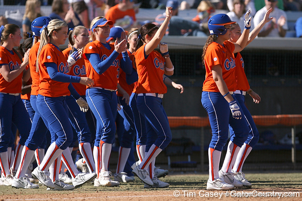photo by Tim Casey<br /> <br /> Florida players celebrate after the Gators' 8-0 win against the Baylor Bears on Saturday, February 7, 2009 at Katie Seashole Pressly Softball Stadium in Gainesville, Fla.