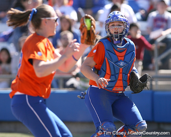 photo by Tim Casey<br /> <br /> Florida sophomore Tiffany DeFelice watches as junior third baseman Corrie Brooks catches a pop-up in foul territory during the fourth inning of the Gators' 8-0 win against the Baylor Bears on Saturday, February 7, 2009 at Katie Seashole Pressly Softball Stadium in Gainesville, Fla.