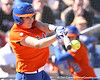 photo by Tim Casey<br /> <br /> Florida junior third baseman Corrie Brooks hits an RBI single during the fifth inning of the Gators' 8-0 win against the Baylor Bears on Saturday, February 7, 2009 at Katie Seashole Pressly Softball Stadium in Gainesville, Fla.