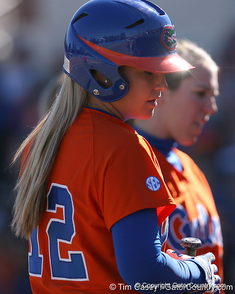 photo by Tim Casey<br /> <br /> Florida sophomore shortstop Megan Bush listens to coaching advice during the fourth inning of the Gators' 8-0 win against the Baylor Bears on Saturday, February 7, 2009 at Katie Seashole Pressly Softball Stadium in Gainesville, Fla.