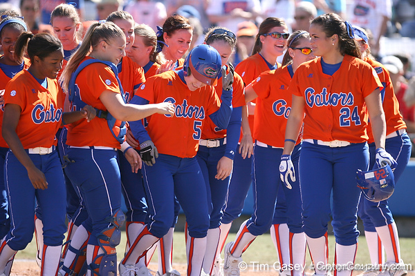 photo by Tim Casey<br /> <br /> Florida players congratulate Kim Waleszonia for hitting a home run in the second inning during the Gators' 8-0 win against the Baylor Bears on Saturday, February 7, 2009 at Katie Seashole Pressly Softball Stadium in Gainesville, Fla.