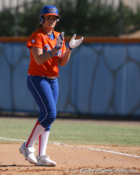photo by Tim Casey<br /> <br /> Florida senior first baseman Ali Gardiner claps after hitting a single in the first inning during the Gators' 8-0 win against the Baylor Bears on Saturday, February 7, 2009 at Katie Seashole Pressly Softball Stadium in Gainesville, Fla.