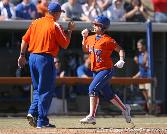 photo by Tim Casey<br /> <br /> Florida head coach Tim Walton congratulates sophomore second baseman Aja Paculba after she hit a home run during the fifth inning of the Gators' 8-0 win against the Baylor Bears on Saturday, February 7, 2009 at Katie Seashole Pressly Softball Stadium in Gainesville, Fla.