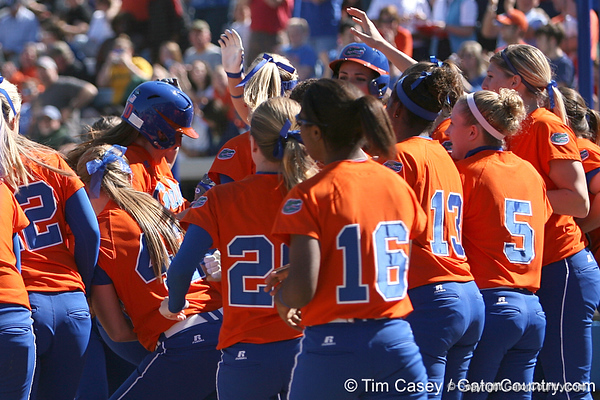 photo by Tim Casey<br /> <br /> Florida junior left fielder Francesca Enea crosses home plate after hitting a three-run home run in the first inning during the Gators' 8-0 win against the Baylor Bears on Saturday, February 7, 2009 at Katie Seashole Pressly Softball Stadium in Gainesville, Fla.