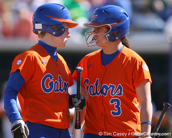 photo by Tim Casey<br /> <br /> Florida senior centerfielder Kim Waleszonia talks with sophomore second baseman Aja Paculba during the first inning of the Gators' 8-0 win against the Baylor Bears on Saturday, February 7, 2009 at Katie Seashole Pressly Softball Stadium in Gainesville, Fla.