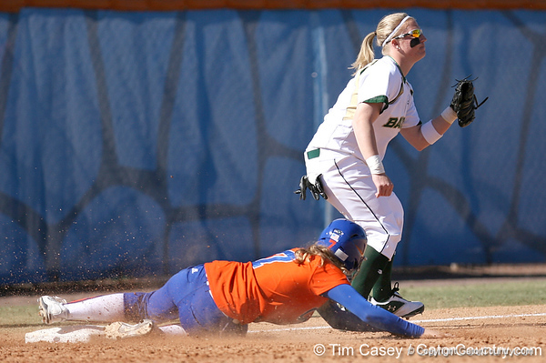 photo by Tim Casey<br /> <br /> Florida freshman Lauren Heil slides into third base during the fifth inning of the Gators' 8-0 win against the Baylor Bears on Saturday, February 7, 2009 at Katie Seashole Pressly Softball Stadium in Gainesville, Fla.