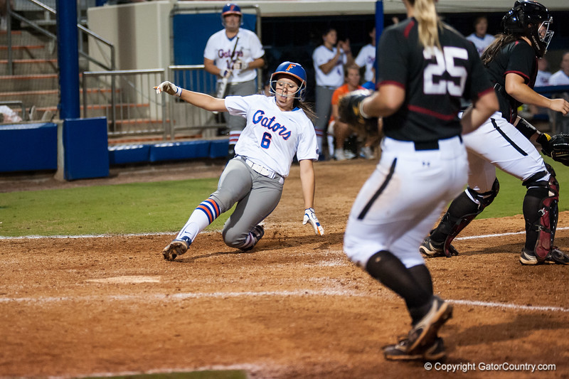 Florida freshman Katie Medina  slides to home plate during the Gators' 9-1 win against the South Carolina Gamecocks on Friday, March 16, 2012 at the Katie Seashole Pressly Softball Stadium in Gainesville, Fla. / Gator Country photo by Saj Guevara