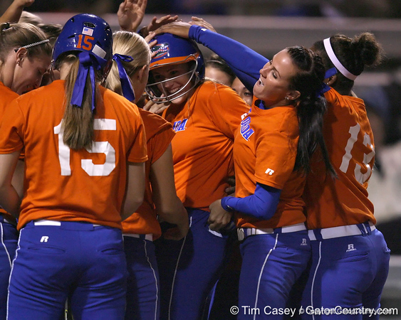 Florida freshman Brittany Schutte gets mobbed by teammates after hitting a home run during the Gators' 8-4 exhibition game win against the Santa Fe College Saints on Thursday, November 5, 2009 at Katie Seashole Pressly Softball Stadium in Gainesville, Fla. / Gator Country photo by Tim Casey