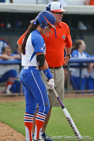Florida senior Kelsey Bruder talks with head coach Tim Walton before retuning to the plate during the Gator's 9-1 victory against the Oregon Ducks in the first day of the NCAA Super Regionals  on Friday, May 27, 2011 at Katie Seashole Pressly Stadium in Gainesville, Fla. / photo by Rob Foldy