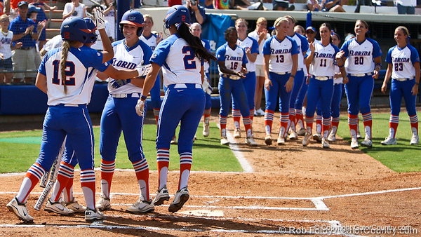 Florida sophomore Brittany Schutte celebrates with her teammates after her first of two homeruns in the Gator's 9-1 victory against the Oregon Ducks in the first day of the NCAA Super Regionals  on Friday, May 27, 2011 at Katie Seashole Pressly Stadium in Gainesville, Fla. / photo by Rob Foldy