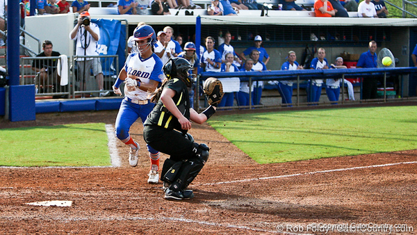 Florida senior Kelsey Bruder runs in to score during the Gator's 9-1 victory against the Oregon Ducks in the first day of the NCAA Super Regionals  on Friday, May 27, 2011 at Katie Seashole Pressly Stadium in Gainesville, Fla. / photo by Rob Foldy